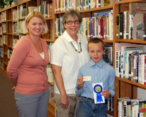 Kenyon Library Director Michelle Otte, SELCO Executive Director Ann Hutton, and Blue Ribbon Reader Thomas Clark